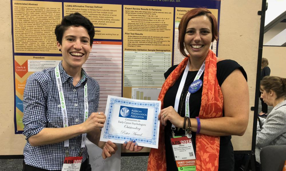 Graduate Student, Nico Storrow, left and Dr. Tiffany O'Shaughnessy, right; in front of award winning poster